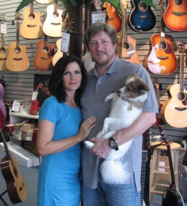 Donna and Steve Willey of Village Music in Wellington, along with their dog Benji.